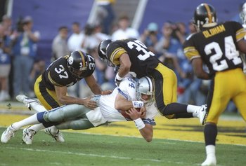 28 Jan 1996:  Tight end Jay Novacek of the Dallas Cowboys gets tackled by Pittsburgh Steelers defensive backs Carnell Lake (left) and Darren Perry during Super Bowl XXX at Sun Devil Stadium in Tempe, Arizona.  The Cowboys won the game, 27-17. Mandatory Cr