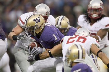 SEATTLE - NOVEMBER 28: Chris Polk #1 of the Washington Huskies carries the ball during the Apple Cup game against the Washington State Cougars on November 28, 2009 at Husky Stadium in Seattle, Washington. The Huskies defeated the Cougars 30-0. (Photo by O
