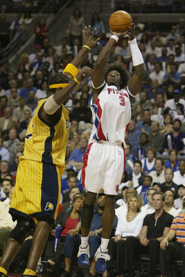 AUBURN HILLS, MI - JUNE 1:  Ben Wallace #3 of the Detroit Pistons shoots over Jermaine O'Neal #7 of the Indiana Pacers in Game six of the Eastern Conference Finals during the 2004 NBA Playoffs at The Palace of Auburn Hills on June 1, 2004 in Auburn Hills,