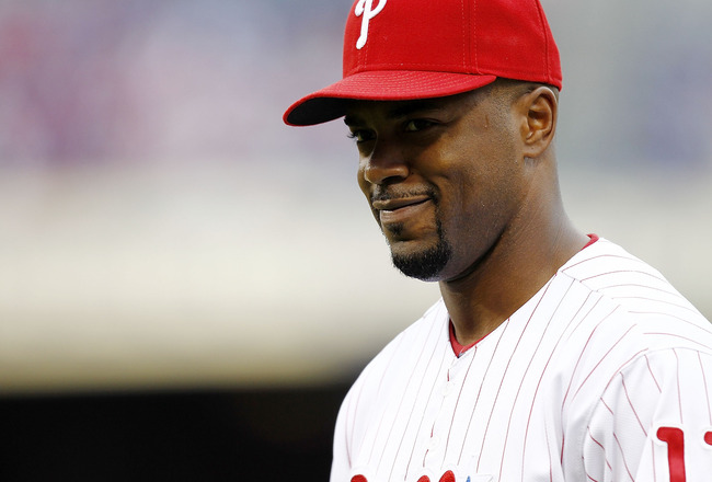 PHILADELPHIA - OCTOBER 06:  Jimmy Rollins #11 of the Philadelphia Phillies warms up before Game 1 of the NLDS against the Cincinnati Reds at Citizens Bank Park on October 6, 2010 in Philadelphia, Pennsylvania.  (Photo by Jeff Zelevansky/Getty Images)