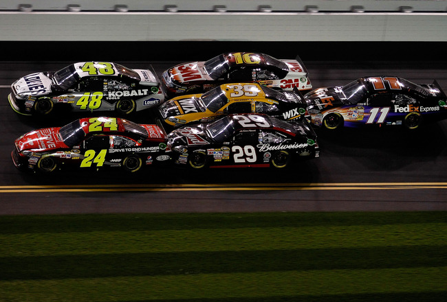 DAYTONA BEACH, FL - FEBRUARY 12:  Jeff Gordon, driver of the #24 Drive to End Hunger Chevrolet, and Jimmie Johnson, driver of the #48 Lowe's Chevrolet, lead Kevin Harvick, driver of the #29 Budweiser Chevrolet, Ryan Newman, driver of the #39 Wix Chevrolet