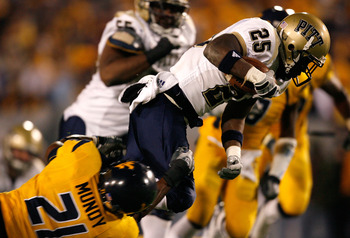 MORGANTOWN, WV - DECEMBER 1:  Running back LeSean McCoy #25 of the Pittsburgh Panthers rushes upfield against defensive back Ryan Mundy #21 of the West Virginia Mountaineers during the second half at Milan Puskar Stadium December 1, 2007 in Morgantown, We
