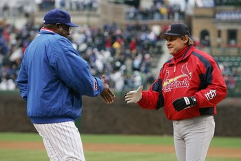 CHICAGO - APRIL 07:  Maqnager Dusty Baker of the Chicago Cubs shakes hands with Manager Tony LaRussa of the St. Louis Cardinals before the Opening Day game on April 7, 2006 at Wrigley Field in Chicago, Illinois. The Cubs defeated the Cardinals 5-1.  (Phot