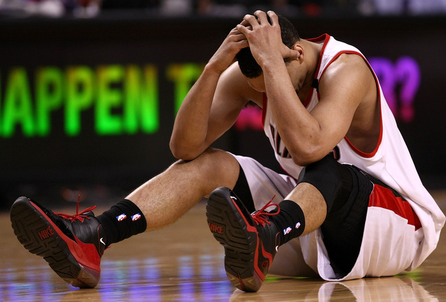 PORTLAND, OR - APRIL 18:  Brandon Roy #7 of the Portland Trail Blazers holds his head after being injured during a scramble for the ball against  the Houston Rockets during Game One of the Western Conference Quarterfinals of the 2009 NBA Playoffs on April