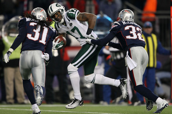 FOXBORO, MA - JANUARY 16:  Wide receiver Braylon Edwards #17 of the New York Jets runs with the ball during their 2011 AFC divisional playoff game against the New England Patriots at Gillette Stadium on January 16, 2011 in Foxboro, Massachusetts.  (Photo