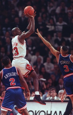 5 MAY 1992:  MICHAEL JORDAN OF THE CHICAGO BULLS RISES ABOVE GREG ANTHONY AND JOHN STARKS, BOTH OF THE NEW YORK KNICKS, TO PUT UP A JUMP SHOT DURING THEIR GAME AT CHICAGO STADIUM IN CHICAGO, ILLINOIS. Mandatory Credit: Jonathan Daniel/ALLSPORT