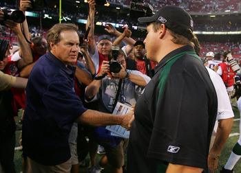 EAST RUTHERFORD, NJ - SEPTEMBER 14: Head coach Eric Mangini (R) of the New York Jets congratulates head coach Bill Belichick of the New England Patriots after their game on September 14, 2008 at Giants Stadium in East Rutherford, New Jersey. The Patriots