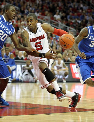 LOUISVILLE, KY - DECEMBER 31:  Chris Smith #5 of the Louisville Cardinals dribbles the ball during the game against the Kentucky Wildcats at the KFC Yum! Center on December 31, 2010 in Louisville, Kentucky. Kentucky won 78-63.  (Photo by Andy Lyons/Getty