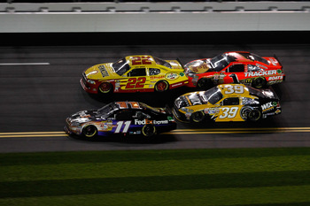 DAYTONA BEACH, FL - FEBRUARY 12:  Denny Hamlin, driver of the #11 FedEx Toyota, crosses the double yellow line to pass resulting in a penalty on the last lap of the NASCAR Budweiser Shootout at Daytona International Speedway on February 12, 2011 in Dayton