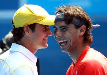 MELBOURNE, AUSTRALIA - JANUARY 16: Rafael Nadal of Spain and Roger Federer of Switzerland enjoy the day during the 'Rally For Relief' charity exhibition match ahead of the 2011 Australian Open at Melbourne Park on January 16, 2011 in Melbourne, Australia.