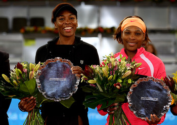 MADRID, SPAIN - MAY 15:  Venus Williams and Serena Williams of the USA hold their trophies after a straight sets victory against Gisela Dulko of Argentina and Flavia Pannetta of Italy in womens doubles final match during the Mutua Madrilena Madrid Open te