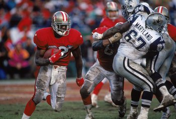 SAN FRANCISCO - JANUARY 15:  Running back Ricky Watters #32 of the San Francisco 49ers runs with the ball during the 1994 NFC Championship game against the Dallas Cowboys at Candlestick Park on January 15, 1995 in San Francisco, California.  The 49ers won