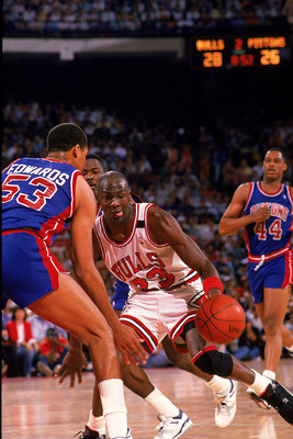 1988:  Michael Jordan #23 of the Chicago Bulls takes the ball to the basket during the game against the Detroit Pistons. NOTE TO USER: It is expressly understood that the only rights Allsport are offering to license in this Photograph are one-time, non-ex