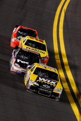DAYTONA BEACH, FL - FEBRUARY 12:  Ryan Newman, driver of the #39 Wix Chevrolet, leads Denny Hamlin, driver of the #11 FedEx Toyota, Kurt Busch, driver of the #22 Shell/Pennzoil Dodge, and Jamie McMurray, driver of the #1 Bass Pro Shops Chevrolet, during t