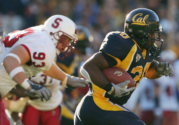 BERKELEY, CA - NOVEMBER 20:  Tailback J.J. Arrington #30 of the University of California, Berkeley Golden Bears carries the ball against the Stanford University Cardinal during the game at Memorial Stadium on November 20, 2004 in Berkeley, California.  Th