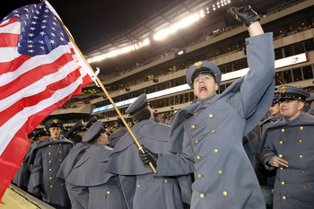 PHILADELPHIA - DECEMBER 11: An Army Cadet waves an American flag and cheers during a game between the Navy Midshipmen and the Army Black Knights on December 11, 2010 at Lincoln Financial Field in Philadelphia, Pennsylvania. The Midshipmen won 31-17. (Phot