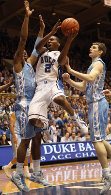 DURHAM, NC - FEBRUARY 09:  Tyler Zeller #44 of the North Carolina Tar Heels tries to stop Nolan Smith #2 of the Duke Blue Devils during their game at Cameron Indoor Stadium on February 9, 2011 in Durham, North Carolina.  (Photo by Streeter Lecka/Getty Ima