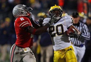 COLUMBUS, OH - NOVEMBER 18:  Mike Hart #20 of the Michigan Wolverines stiff arms Malcolm Jenkins #2 of the Ohio State Buckeyes in the third quarter November 18, 2006 at Ohio Stadium in Columbus, Ohio.  (Photo by Gregory Shamus/Getty Images)