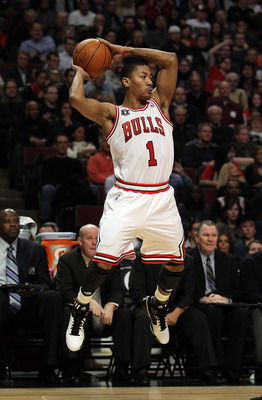 CHICAGO, IL - JANUARY 28: Derrick Rose #1 of the Chicago Bulls leaps to pass against the Orlando Magic at the United Center on January 28, 2011 in Chicago, Illinois. The Bulls defeated the Magic 99-90. NOTE TO USER: User expressly acknowledges and agrees
