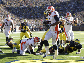 ANN ARBOR, MI - NOVEMBER 06:  Mikel Leshoure of the Illinios Fighting Illini scores a triple overtime touchdown while playing the Michigan Wolverines at Michigan Stadium on November 6, 2010 in Ann Arbor, Michigan. Michigan won the game 67-65. (Photo by Gr