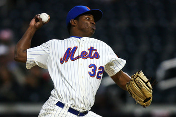 NEW YORK - SEPTEMBER 15:  Jenrry Mejia #32 of the New York Mets pitches against the Pittsburgh Pirates on September 15, 2010 at Citi Field in the Flushing neighborhood of the Queens borough of New York City.  (Photo by Andrew Burton/Getty Images)