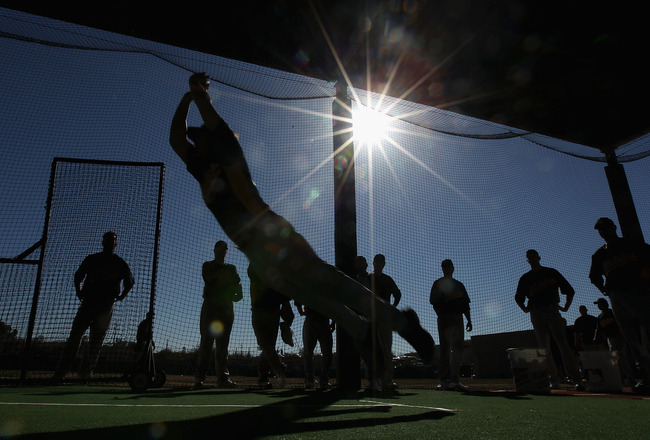 PHOENIX, AZ - FEBRUARY 16:  Pitcher Danny Farquhar #63 of the Oakland Athletics participates in a jumping drill during a MLB spring training practice at Phoenix Municipal Stadium on February 16, 2011 in Phoenix, Arizona.  (Photo by Christian Petersen/Gett