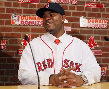 BOSTON, MA - DECEMBER 11:  Carl Crawford answers questions during a press conference to announce his joining the Boston Red Sox on December 11,  2010 at the Fenway Park in Boston, Massachusetts.  (Photo by Elsa/Getty Images)