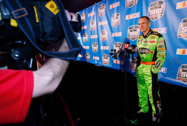DAYTONA BEACH, FL - FEBRUARY 10:  Mark Martin, driver of the #5 GoDaddy.com Chevrolet, speaks to the media during the 2011 NASCAR Media Day at Daytona International Speedway on February 10, 2011 in Daytona Beach, Florida.  (Photo by Todd Warshaw/Getty Ima