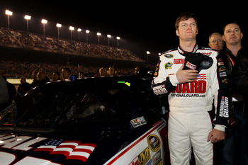 DAYTONA BEACH, FL - FEBRUARY 12:  Dale Earnhardt Jr., driver of the #88 National Guard/AMP Energy Chevrolet, stands by his car prior to the NASCAR Budweiser Shootout at Daytona International Speedway on February 12, 2011 in Daytona Beach, Florida.  (Photo