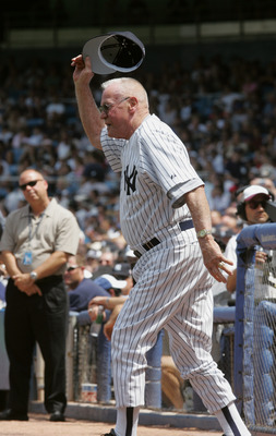 NEW YORK - JULY 9:  Hank Bauer waves to the fans during the New York Yankees 59th annual old-timers' day before the start of the Yankees game against the Cleveland Indians on July 9, 2005 at Yankee Stadium in the Bronx borough of New York City. The Indian