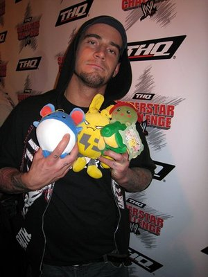 CM Punk holding various Pokemon plushies.