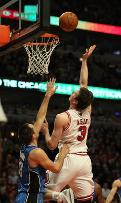 CHICAGO, IL - JANUARY 28: Omer Asik #3 of the Chicago Bulls puts up a shot over Ryan Anderson #33 of the Orlando Magic at the United Center on January 28, 2011 in Chicago, Illinois. The Bulls defeated the Magic 99-90. NOTE TO USER: User expressly acknowle