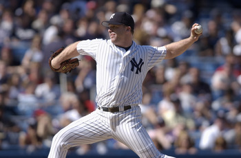 BRONX - MAY 5:  Pitcher Mike Stanton #29 of the New York Yankees throws a pitch during the MLB game against the Seattle Mariners at Yankee Stadium in the Bronx, New York on May 5, 2002. The Mariners defeated the Yankees 10-6. (Photo by Ezra Shaw/Getty Ima