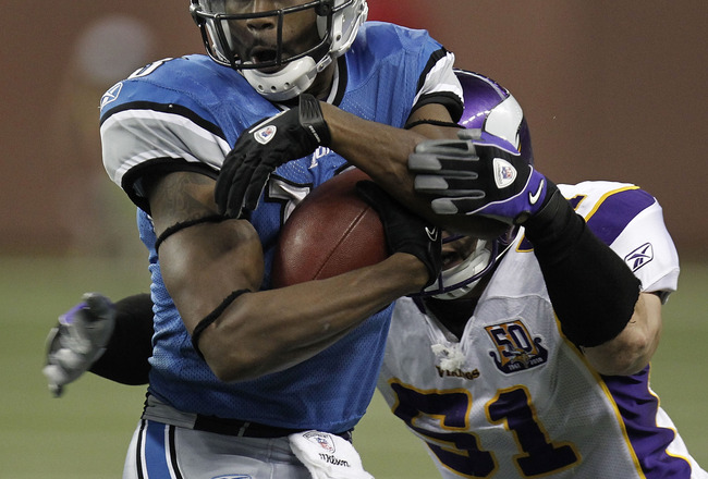 DETROIT, MI - JANUARY 02:  Nate Burleson #13 of the Detroit Lions tries to get past the tackle of Ben Leber #51 of the Minnesota Vikings at Ford Field on January 2, 2011 in Detroit, Michigan.  (Photo by Gregory Shamus/Getty Images)