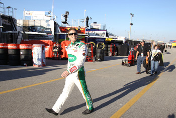 DAYTONA BEACH, FL - FEBRUARY 11:  Carl Edwards, driver of the #99 Scotts Ford, walks in the garage area during practice for the NASCAR Budweiser Shootout at Daytona International Speedway on February 11, 2011 in Daytona Beach, Florida.  (Photo by Matthew