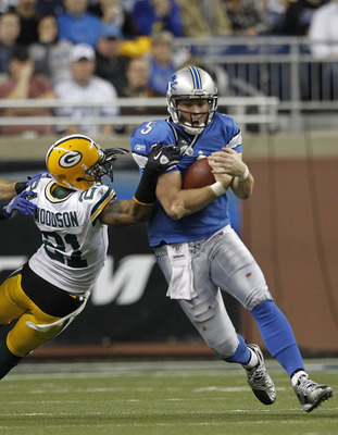 DETROIT - DECEMBER 12:  Drew Stanton #5 of the Detroit Lions runs for a first down as Charles Woodson #21 of the Green Bay Packers attempts to make the stop during the game at Ford Field on December 12, 2010 in Detroit, Michigan. The Lions defeated the Pa
