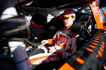 DAYTONA BEACH, FL - FEBRUARY 12:  Joey Logano, driver of the #20 Home Depot Toyota, sits in his car during practice for the NASCAR Sprint Cup Series Daytona 500 at Daytona International Speedway on February 12, 2011 in Daytona Beach, Florida.  (Photo by C