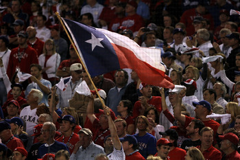ARLINGTON, TX - NOVEMBER 01:  A fan waves a Texas state flag while the Texas Rangers play against the San Francisco Giants in Game Five of the 2010 MLB World Series at Rangers Ballpark in Arlington on November 1, 2010 in Arlington, Texas.  (Photo by Doug