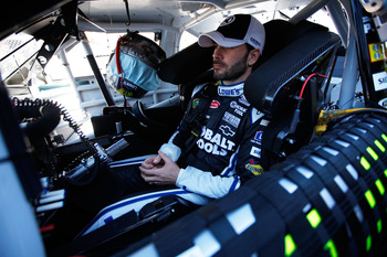 DAYTONA BEACH, FL - FEBRUARY 12:  Jimmie Johnson, driver of the #48 Lowe's Chevrolet, sits in his car during practice for the NASCAR Sprint Cup Series Daytona 500 at Daytona International Speedway on February 12, 2011 in Daytona Beach, Florida.  (Photo by