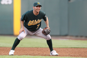 ARLINGTON, TX - JULY 29: First baseman Adam Rosales #7 of the Oakland Athletics on July 29, 2010 at Rangers Ballpark in Arlington, Texas.  (Photo by Ronald Martinez/Getty Images)