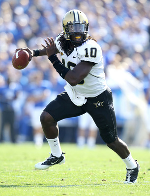 LEXINGTON, KY - NOVEMBER 13:  Larry Smith #10 of the Vanderbilt Commodores runs with the ball during the game against the Kentucky Wildcats  at Commonwealth Stadium on November 13, 2010 in Lexington, Kentucky.  (Photo by Andy Lyons/Getty Images)