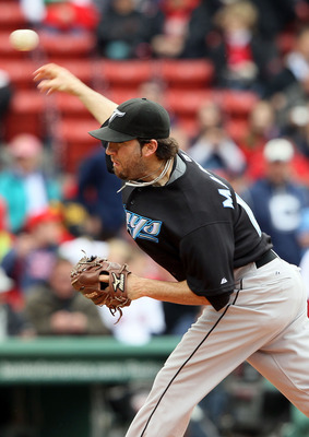 BOSTON - MAY 12:  Shaun Marcum #28 of the Toronto Blue Jays delivers a pitch in the first inning against the Boston Red Sox on May 12, 2010 at Fenway Park in Boston, Massachusetts.  (Photo by Elsa/Getty Images)