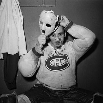 http://www.sportsvideodaily.com/wp-content/uploads/2009/11/jacques_plante_putting_on_mask_gr75.jpg