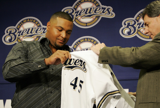 MILWAUKEE - JANUARY 10:  General manager Doug Melvin (R)  introduces Carlos Lee as #45 of the Milwaukee Brewer as he hands him his jersey January 10, 2005 at Miller Park in Milwaukee, Wisconsin.   (Photo by Brian Bahr/Getty Images)
