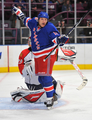 NEW YORK, NY - JANUARY 25: Sean Avery #16 of the New York Rangers reacts after colliding with Tomas Vokoun #29 of the Florida Panthers during the second period at Madison Square Garden on January 25, 2011 in New York City. (Photo by Christopher Pasatieri/
