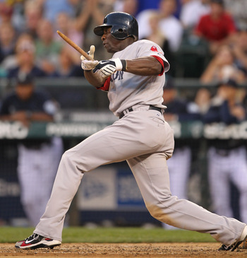 SEATTLE - JULY 23: Mike Cameron #23 of the Boston Red Sox breaks his bat against the Seattle Mariners at Safeco Field on July 23, 2010 in Seattle, Washington. (Photo by Otto Greule Jr/Getty Images)