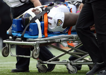 FOXBORO, MA - OCTOBER 04:  Jared Gaither #71 of the Baltimore Ravens is taken off the field by a stretcher in the first half against the New England Patriots on October 4, 2009 at Gillette Stadium in Foxboro, Massachusetts.  (Photo by Elsa/Getty Images)