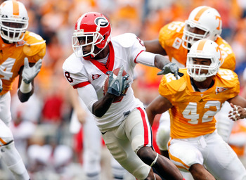KNOXVILLE, TN - OCTOBER 10: A.J. Green #8 of the Georgia Bulldogs runs with the ball after a reception during the SEC game against the Tennessee Volunteers at Neyland Stadium on October 10, 2009 in Knoxville, Tennessee. (Photo by Andy Lyons/Getty Images)