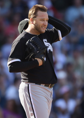 BOSTON - SEPTEMBER 05:  Mark Buehrle #56 of the Chicago White Sox reacts after giving up a two run homer to Victor Martinez of the Boston Red Sox in the seventh inning on September 5, 2010 at Fenway Park in Boston, Massachusetts.  (Photo by Elsa/Getty Ima