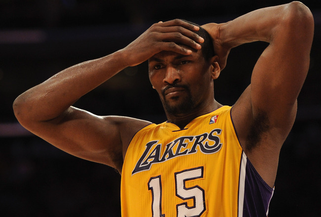 LOS ANGELES, CA - FEBRUARY 03:  Ron Artest #15 of the Los Angeles Lakers reacts on defense after a San Antonio Spurs basket during a 89-88 Spur win at Staples Center on February 3, 2011 in Los Angeles, California.  NOTE TO USER: User expressly acknowledge